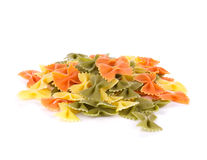 Bunch of the farfalle pasta three colors. Stock Photo