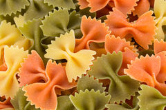 Bunch of the farfalle pasta three colors. Stock Images