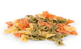 Bunch of the farfalle pasta. Three colors. Whole background royalty free stock photography