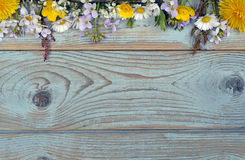 Bunch of fieldflowers,daisies, buttercups, Pentecostal flowers, dandelions on a oldwooden background with empty copy space Royalty Free Stock Photos