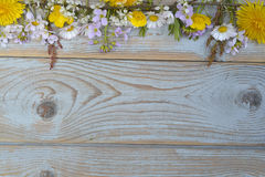 Bunch of fieldflowers,daisies, buttercups, Pentecostal flowers, dandelions on a oldwooden background with empty copy space Royalty Free Stock Photography