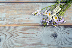 Bunch of fieldflowers,daisies, buttercups, Pentecostal flowers, dandelions on a oldwooden background with empty copy space Royalty Free Stock Images