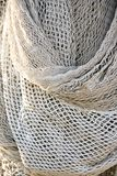 Bunch of fishing trawl net hanging on a trawler boat. Background royalty free stock images