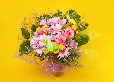 Bunch of flowers. On yellow background Royalty Free Stock Images