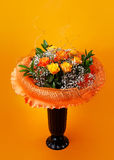 Bunch of flowers. On orange background Royalty Free Stock Photo