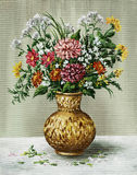 Bunch of flowers in a African vase Stock Images