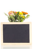 Bunch of flowers with blackboard stock images