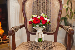 Bunch of flowers on a chair. Royalty Free Stock Photography