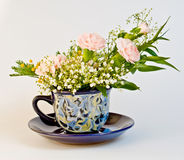 Bunch of flowers in cup Royalty Free Stock Photos