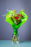Bunch of flowers with dew drops in a glass vase Royalty Free Stock Photography