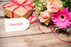 Bunch of flowers with a gift box and tag Royalty Free Stock Image