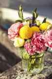 Bunch of flowers in a glass jar Stock Images