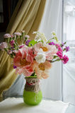 Bunch of flowers in a glass vase Stock Photo