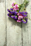 Bunch of flowers on grunge wooden background Royalty Free Stock Photos