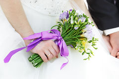 Bunch of flowers in hands of the bride Stock Photography