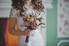 Bunch of flowers in hands of the bride 2646. Royalty Free Stock Photography