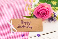 Happy Birthday card with pink rose flower. Bunch of flowers with Happy Birthday card on wooden background stock photos