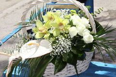 Bunch of flowers outdoors in a basket for a bride Royalty Free Stock Photos