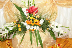 Bunch of flowers outdoors in a basket for a bride Stock Photography