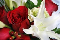 Bunch of flowers, red roses and white lys Royalty Free Stock Image