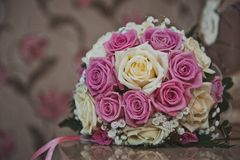 Bunch of flowers from roses on a table 2379. Royalty Free Stock Image