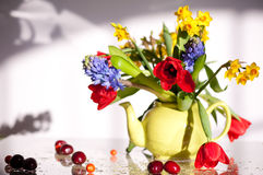 Bunch of flowers in a teapot Stock Image