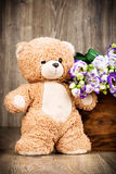 Bunch of flowers and a teddy bear Stock Images