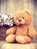 Bunch of flowers and a teddy bear Stock Image