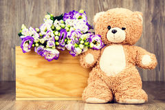 Bunch of flowers and a teddy bear Royalty Free Stock Photography