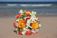 Bunch of flowers on a tropical beach Stock Photo