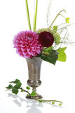 Bunch of flowers in a vase. Several colourful flowers in a silver vase royalty free stock images