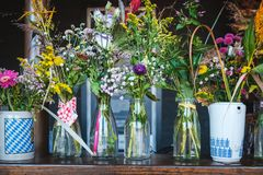 Bunch of flowers in vase - flower bouquets in glasses on counte royalty free stock photos