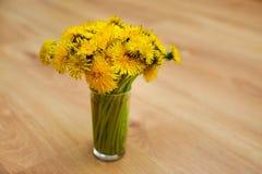 Bunch of flowers. Yellow summer dandelions bouquet Stock Image
