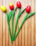 Bunch of four fake tulips Stock Images