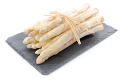 Bunch of fresh asparagus on a slate tray Stock Image