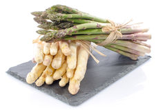 Bunch of fresh asparagus on a slate tray Stock Images