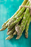 Bunch of fresh asparagus on turquoise background Royalty Free Stock Photography