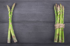 Bunch of fresh asparagus on wooden rustic background. Copy space Royalty Free Stock Image