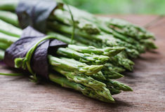 Bunch of fresh asparagus on wooden Royalty Free Stock Images
