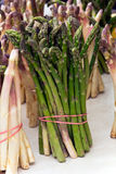 Bunch of fresh asparagus on wooden table Stock Images