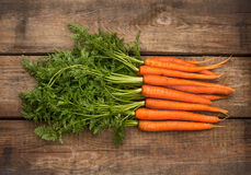 Bunch of fresh carrots over wooden background Royalty Free Stock Image