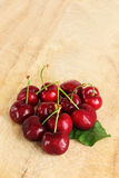 A bunch of fresh cherries, with a leaf Stock Photos