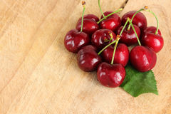 A bunch of fresh cherries, with a leaf Stock Image