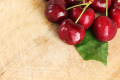 A bunch of fresh cherries, with a leaf Royalty Free Stock Photo