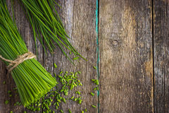 Bunch of fresh chives on a wooden cutting board Royalty Free Stock Images