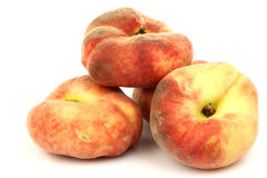 A bunch of fresh colorful flat peaches  Stock Photo