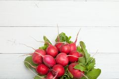 Bunch fresh diet radish, rustic background. Copy space for text.  stock images