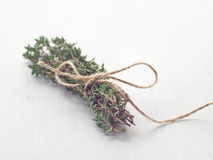 Bunch of fresh garden thyme arranged on white wooden table. Selective focus. Copy space for your text Stock Images