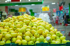 Bunch of fresh green apples in supermarket Royalty Free Stock Image