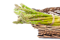Bunch of fresh green asparagus. In the basket Royalty Free Stock Photos